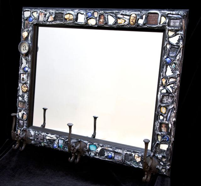 Mosaic mirror with cast-iron hooks.